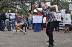 "Members of Graduate Assistants United perform a flash mob to ""Thriller"" as a part of their ""Spring Broke"" rally to support the decrease of graduate assistant fees in Turlington Plaza on"
