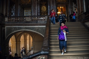A visitor descends the stairs in Château de Versailles on September 25, 2015.